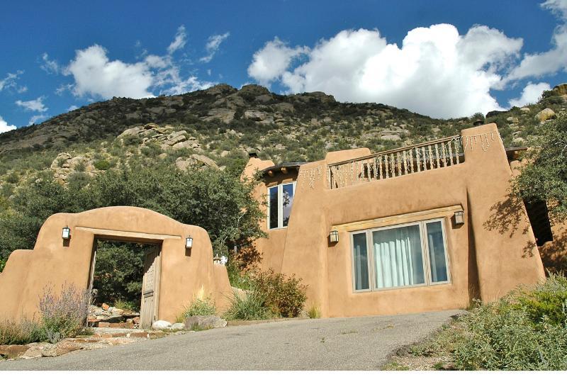 Sandia Mountain Magic house from driveway. - 5 BDR, Gorgeous Adobe, Spectacular Setting w/Views - Albuquerque - rentals