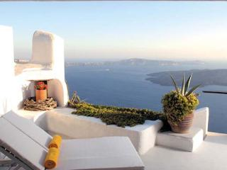 300 meters above the sea on the cliffs edge in peaceful Imerovigli. VMS ILO - Firostefani vacation rentals