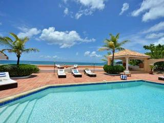Directly on Baie rouge Beach, surrounded by tropical gardens. All rooms open to tiled terrace and pool. C ROD - Baie Rouge vacation rentals