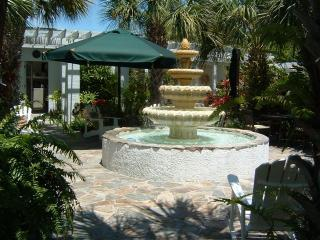 Relax in the courtyard surrounded by lush tropical gardens - Luxury Beach Vacation Rental on Anna Maria Island - Holmes Beach - rentals