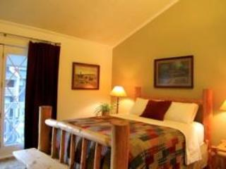 Master bedroom with private bath and balcony - Ski-In/Ski-Out!! Unbeatable Location-2 balconies! - Red River - rentals