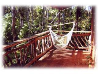 Master bedroom lanai with hammock chair - Lazy Lehua Cottage ~ Charming & Whimsical - Volcano - rentals