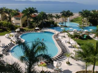 Condo view of ocean, pool and resort property - Puerto Vallarta, Beach Front Condo, Portofino - Puerto Vallarta - rentals