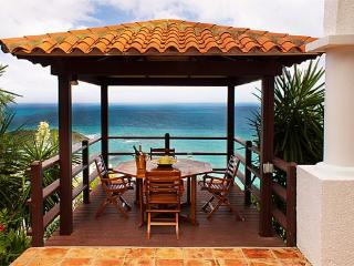 LEONES....Private love nest high on a hill with outstanding views of the ocean and St Barths - Oyster Pond vacation rentals