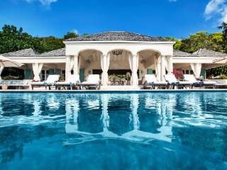 Palladian style Bon Temps on one-level, 50 ft infinity edge pool & lush tropical gardens - Pointe Milou vacation rentals