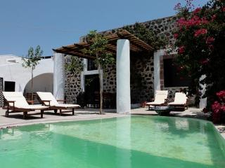 Situated on a quiet path in the quaint village of Megalochori, with vineyards in the distance. VMS KIA - Firostefani vacation rentals