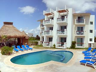 2 bedroom beachfront condos with good sized pool.  WiFi, Air Con, Sat TV! - Akumal vacation rentals