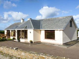 STRAND COTTAGE, pet friendly, open fires, en-suite, sea views in Derrybeg, Ref 15997 - Falcarragh vacation rentals
