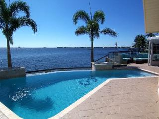 The River View - SE Cape Coral Riverfront, Luxury Pool Home, Contemporary Furnished, Sony Playstation 3, Pool Table and much more...... - Cape Coral vacation rentals