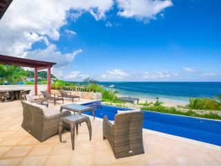 Escape Into Beachfront Luxury at Pristine Bay - West End vacation rentals