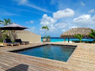 Karibuni - Modern villa with private suite on the 2nd level & ocean access right off the deck - Bonaire vacation rentals