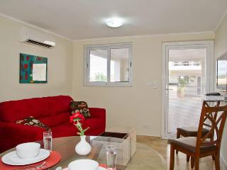Royal Palm Resort. Colorful  one bedroom apartment. In upscale Piscadera Bay. - Willemstad vacation rentals