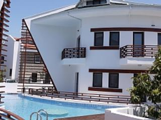 Fire Opal A3 is on the opposite side of this building facing the mountains - Modern 3 bed apartment a stones throw to riverside - Dalyan - rentals