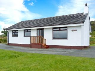 DEO-NA-MARA, single-storey cottage, spacious accommodation, enclosed gardens, sea and mountain views, in Borreraig, near Dunvega - Dunvegan vacation rentals