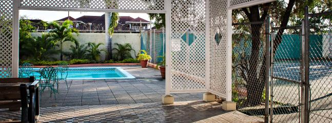 Take a dip in the pool or entertain in the large gazebo - Manor Court Mews Luxury Condo in Kingston, Jamaica - Kingston - rentals