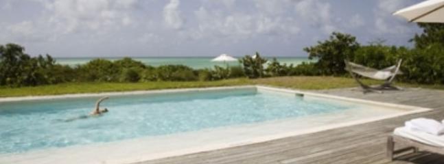 Cozy 3 Bedroom Beachfront Villa in Parrot Cay - Image 1 - Parrot Cay - rentals