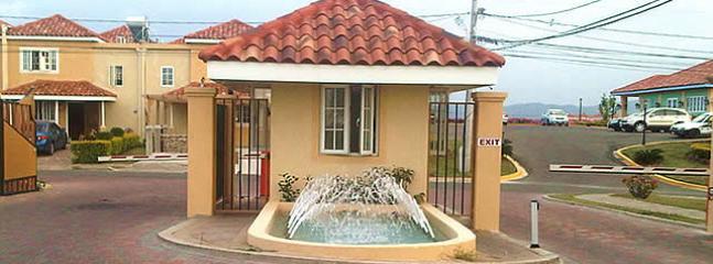 GATED COMMUNITY ENTRANCE - MONTEGO BAY, JA - BEAUTIFUL, SUNNY & BRIGHT TOWNHOUSE - Montego Bay - rentals