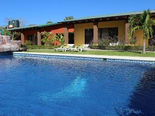 Colorful gardens, pool, hammocks and bbq! 6 Person - Playa Potrero vacation rentals