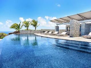 Captivating La Danse des Etoiles Villa with solar heated pool and al fresco dining - Pointe Milou vacation rentals