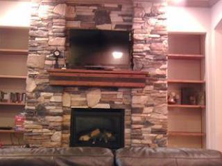 Beautiful stone fireplace great to light up for a cozy evening - # A6 Coral Springs Resort - Hurricane - rentals