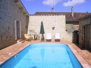 Two restored cottages; sleeps 13; pool; gardens - Larressingle vacation rentals