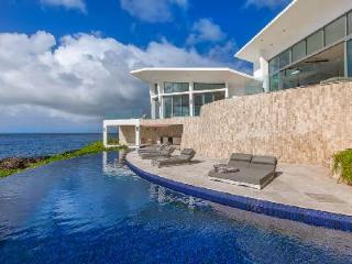 Oceanfront Beauty with Asian Flair, Volcanic Rock, Grotto - Villa Kishti - Limestone Bay vacation rentals