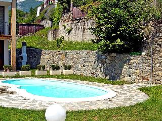 Design apt on lake with pool - Montemezzo vacation rentals