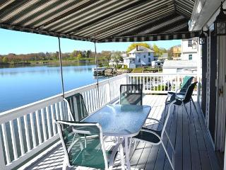 Afternoon Delight: Toast the beauty of the river from the waterfront deck - Salem vacation rentals