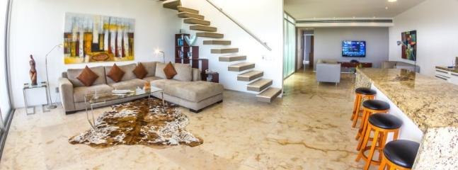 SPACIOUS LIVING AREA, TELEVISION AREA, AND KITCHEN - Magia Playa Penthouse 2-F - MGPH2-F - Playa del Carmen - rentals