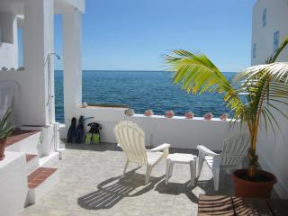 Enjoy crystal clear waters off your private patio! - Nassau vacation rentals