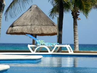 Luxurious Beach Front Condo with Spectacular Views - Puerto Aventuras vacation rentals