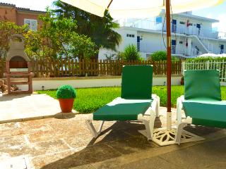 Neptuno Beach, lovely garden, only 50 Mts.. to t - Alcudia vacation rentals