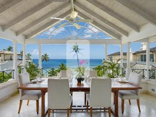 Stunning views of the free-form swimming pool, lush tropical gardens and Caribbean Sea beyond - Speightstown vacation rentals