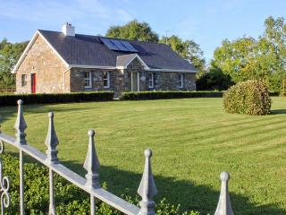GRANGE LODGE, detached cottage on the banks of Grange Lough, all ground floor, open fire, garden with furniture, near Strokestow - Boyle vacation rentals