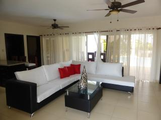 NEW VILLA! What a find! Decor is exceptional yet comfortable. 9722 gal rainbow lit pool with sunbed ledge with beautiful garden  - Cabarete vacation rentals