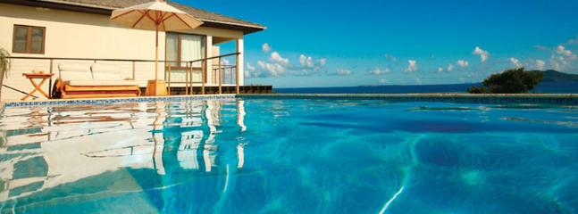 AVAILABLE CHRISTMAS & NEW YEARS: Anguilla Villa 48 The Surrounding Waters Are Protected By A Reef, Which Makes For Calm Waters A - Little Harbour vacation rentals