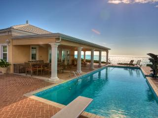 Three Dolphins Sandy Beachfront Tennis Villa - Long Bay Beach vacation rentals