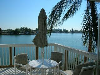 watch the dolphins from your balcony! - Treasure Island vacation rentals