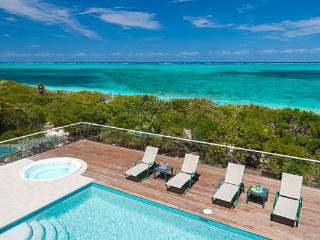 Nestled amid lush, tropical landscaping, this villa fronts miles of white sandy beach. TNC DAW - Grace Bay vacation rentals