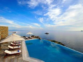 Eros overlooking the Bay of Agios Lazaro with infinity pool, helipad & dock access - Mykonos vacation rentals