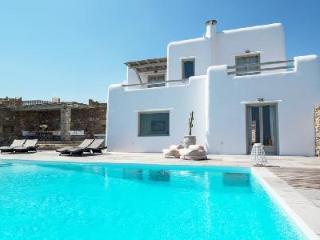 Modern Poseidon One with 3 stone façade villas, superb bay views & infinity pool - Kalafatis vacation rentals