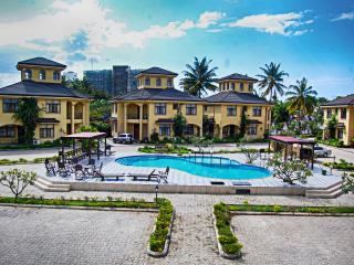 Spacious coastal villa in bustling Dar es Salaam, Tanzania, with 4 bedrooms, air con, WiFi and pool - Dar es Salaam vacation rentals