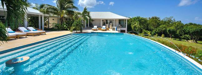 SPECIAL OFFER: St. Martin Villa 84 The Absolute Tranquility And Magnificent Views In Late Afternoon Hours Make This Gorgeous, Spacious And Beautifully Decorated House An Extremely Attractive Choice. - Image 1 - Terres Basses - rentals
