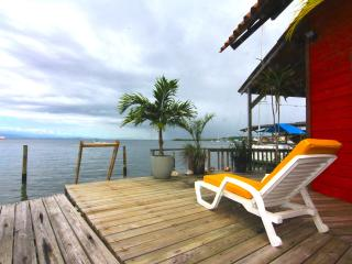 OVER THE WATER RENTALS - footsteps from the beach - Carenero Island vacation rentals