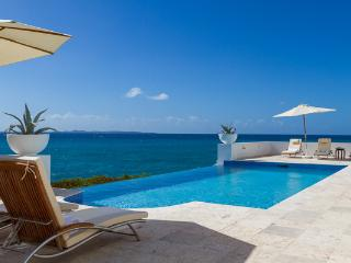 With an infinity pool overlooking the sea and St. Martin, this villa, on a private small beach, also has great snorkeling. IDP VIS - Little Dix vacation rentals