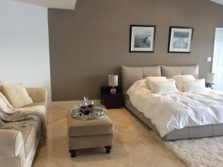 Master bedroom in a waterfront home - North Bay Village vacation rentals