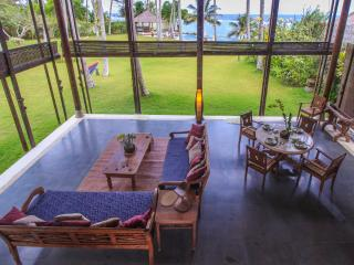 Oceanfront villa Yoga Bale with tennis court - Candidasa vacation rentals
