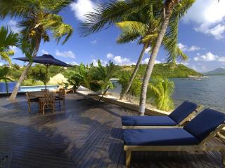 ELYSIUM... gorgeous villa w/ small, very private Lagoon beach, home theater & gym! - Terres Basses vacation rentals